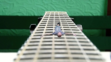 crucified: Crucified on guitar Stock Photo