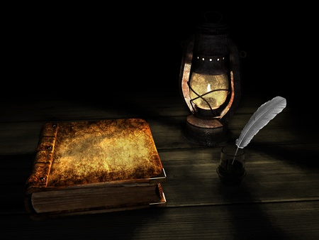 old book and kerosene lamp photo
