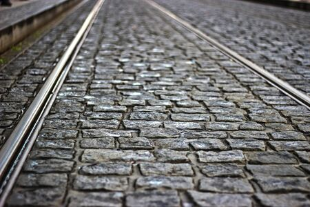 cobblestones: Tram tracks in cobblestones Stock Photo