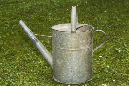 old metal: Old metal water can for gardening Stock Photo