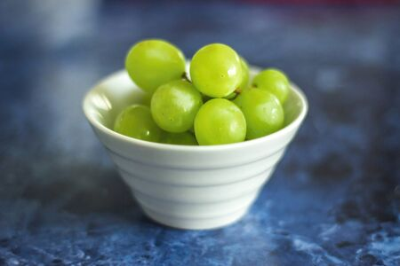 Green grapes in white bowl