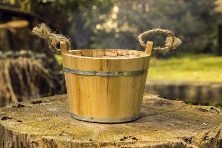 Old wood bucket on the stump Stock fotó