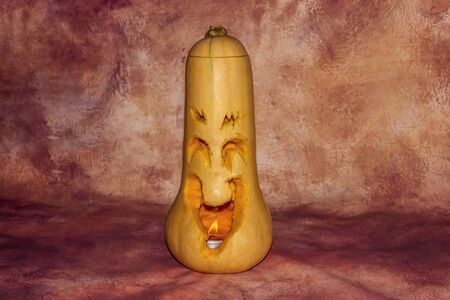 Scary Halloween pumpkin carved smilling
