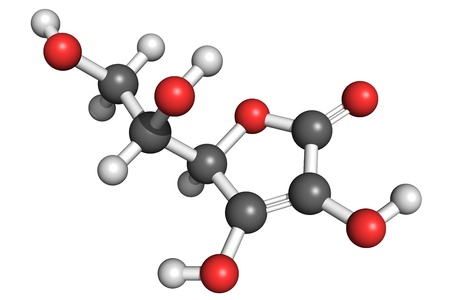 Ball and stick model of L-ascorbic acid (vitamin C). Atoms are coloured according to convention (carbon-grey, hydrogen-white, oxygen-red). Vitamin C is an important antioxidant, immune system booster and antihistamine. Deficiency results in scurvy. Stock Photo