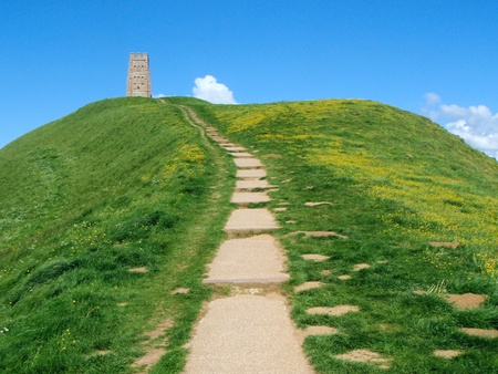 hill of the king: Blue sky and the green hill from Glastonbury Tor in spring  Stock Photo