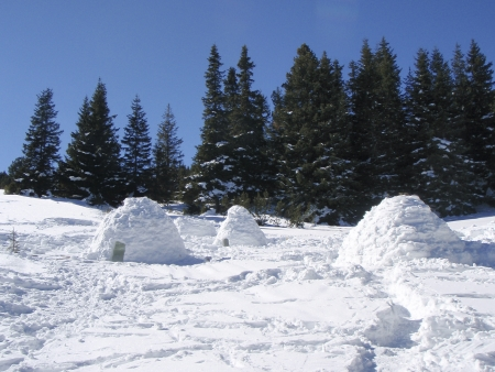 igloo: Snow igloos in a winter mountain Stock Photo