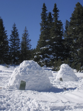 Snow igloos in a winter mountain Stock Photo
