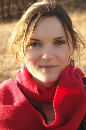 Beautiful young woman with a red scarf smiling Stock Photo - 11134045