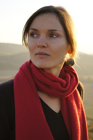 Beautiful young woman with a red scarf on sunset Stock Photo