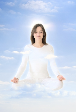 aura: Beautiful young woman raising in the sky, meditating in the clouds