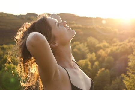 A beautiful girl relaxes in gentle sunlight Stock Photo - 13443651