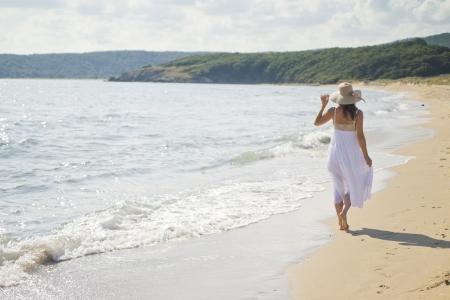 bulgaria girl: A beautiful young woman takes a relaxing walk along a sandy beach Stock Photo