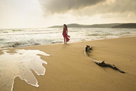 bulgaria girl: Young woman on a wild beach enjoying the natural beauty