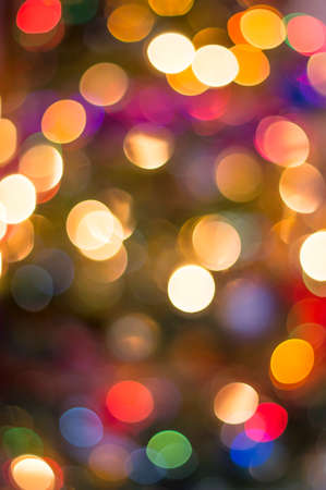 Colorful defocused christmass tree lights background photo