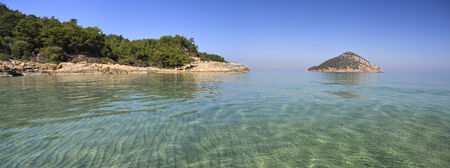 thassos: Panoramic view of the pure waters of the Mediterranean sea at the Paradise beach on the island of Thassos, Greece Stock Photo