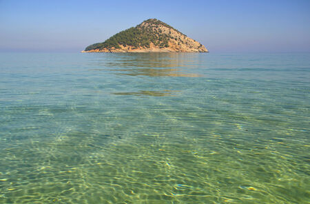 thassos: The pure waters of the Mediterranean sea at the Paradise beach on the island of Thassos, Greece Stock Photo