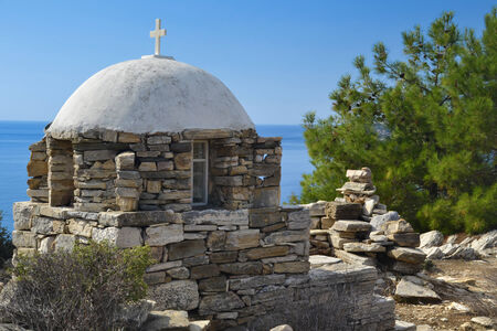 Small greek chapel on the edge of a cliff on the island ot Thassos, Greece. photo