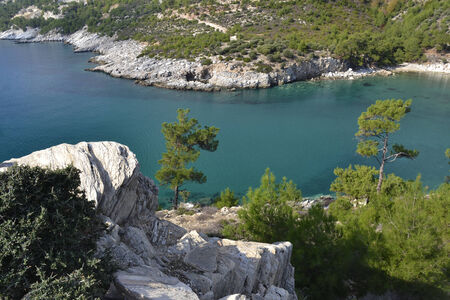The turquoise waters of the aegean sea at the island ot Thassos, Greece. photo