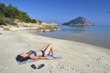 thassos: Beautiful young woman enjoying the sunshine and pristine nature at Paradise beach on the island of Thassos, Greece