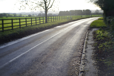 lonelyness: Road going through the british countryside. Stock Photo
