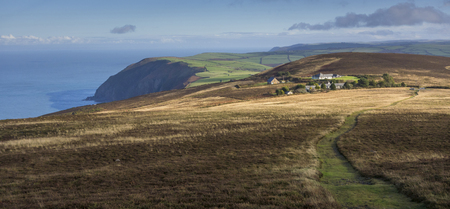 lynton: Panoramic image of the high cliffs raising above the sea in the norht of Devon, England.