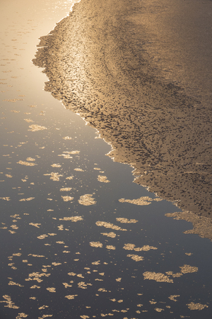 evaporation: Beautiful texture created by the salt crystals form in the process of natural evaporation of sea water.