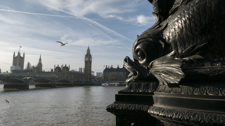 sea of houses: Sea monster architectural detail is threatening to eat the Houses Of Parliament in London. Stock Photo