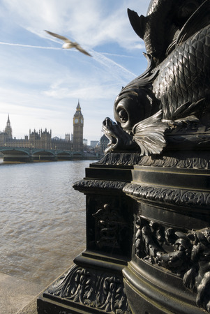 sea monster: Sea monster architectural detail is threatening to eat the Houses Of Parliament in London. Stock Photo