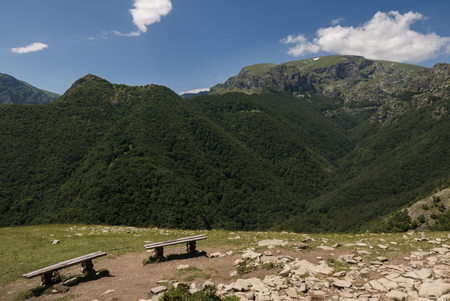 Two benches overlooking the highest peak in Central Balkan National Park - Mount Botev, Bulgaria.