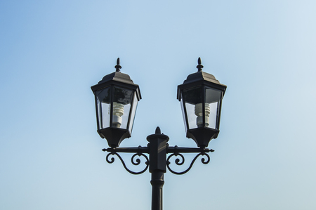 dual: Dual lamp on blue sky background.