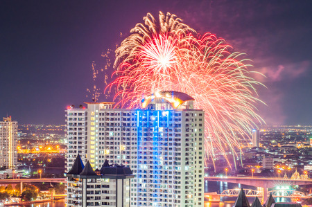nightlife view city scape of Bangkok with fireworks.