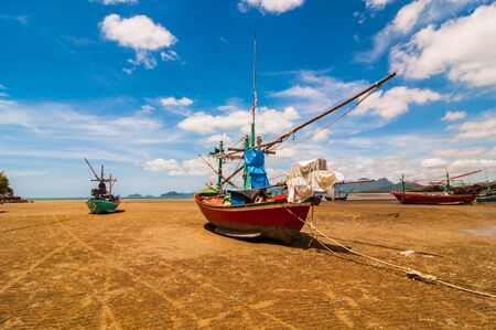 fishingboat: Fishing boat on the beachthailand.