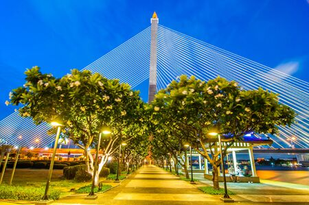 rama: Rama VIII Bridge at night in Bangkok Thailand Stock Photo