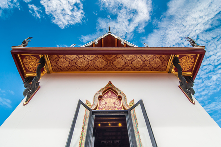 nagpur: Under looking view pagoda with blue sky background in Buddhist temple Thailand. Stock Photo
