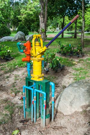 quencher: hand pump groundwater Stock Photo