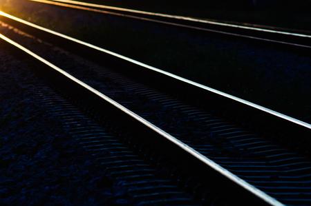 railway tracks: railway tracks in the shadow light of sunset.
