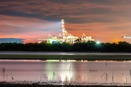 mountings: Twilight Sunset view at Laemchabang Port,Thailand. Stock Photo