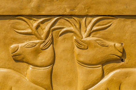 carved stone: Carved stone deer. Stock Photo