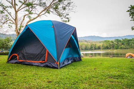bulging: Camping Tent by Lake Forest Chet Khot bulging piece of stone used as stove. Stock Photo
