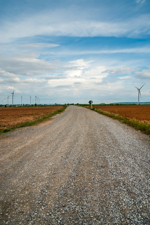 Road for Wind turbines generate electricity at field all agriculture plantation in thailand