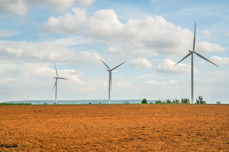 Wind turbines generate electricity at field all agriculture plantation in thailand