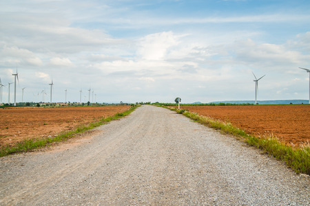 generate: Road for Wind turbines generate electricity at field all agriculture plantation in thailand