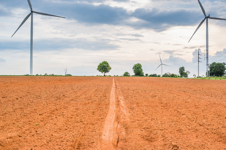 generate: Wind turbines generate electricity at field all agriculture plantation in thailand
