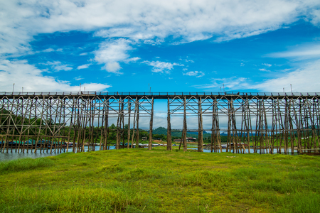 river: (Mon Bridge) Wooden bridge over the river in Sangkhlaburi District, Kanchanaburi, Thailand. Stock Photo