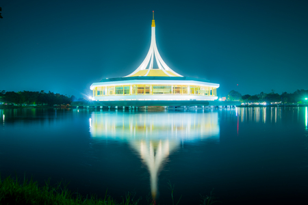 Beautiful building with reflex on the lagoon against blue sky in public park, Suanluang Rama 9, Thailand