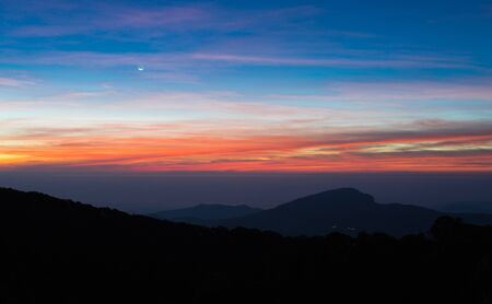 dept: The silhouette mountain view before sunrise in winter of Thailand. This image taking by shallow focus dept of field.