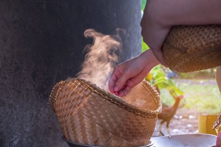 The steamed sticky rice, the way of life of the villagers in the rural northeast of the country, Thailand.