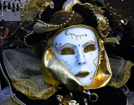 a masked woman is dressed for carnivale in venice,Italy photo