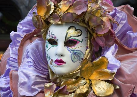 carnivale: woman with colorful mask at Carnivale in Venice Italy