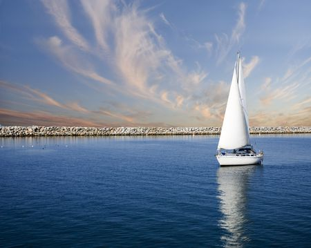 maneuvering:  sailboat on peaceful still waters in a harbor